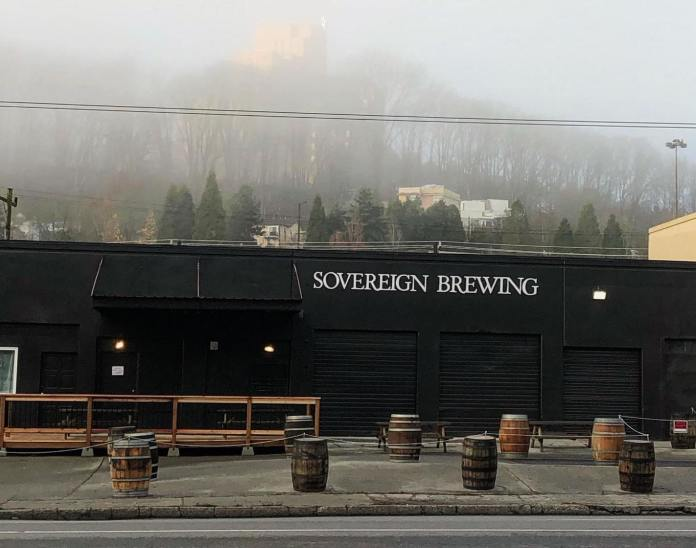 Sovereign Brewing use barrels with ropes to cordon off a patio space.