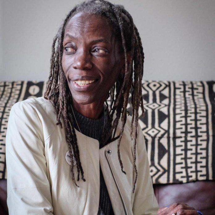 JoAnn Hardesty is a black woman with tight dreadlocks.