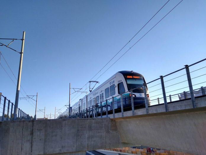 A photo of a light rail train on an elevated rail line.