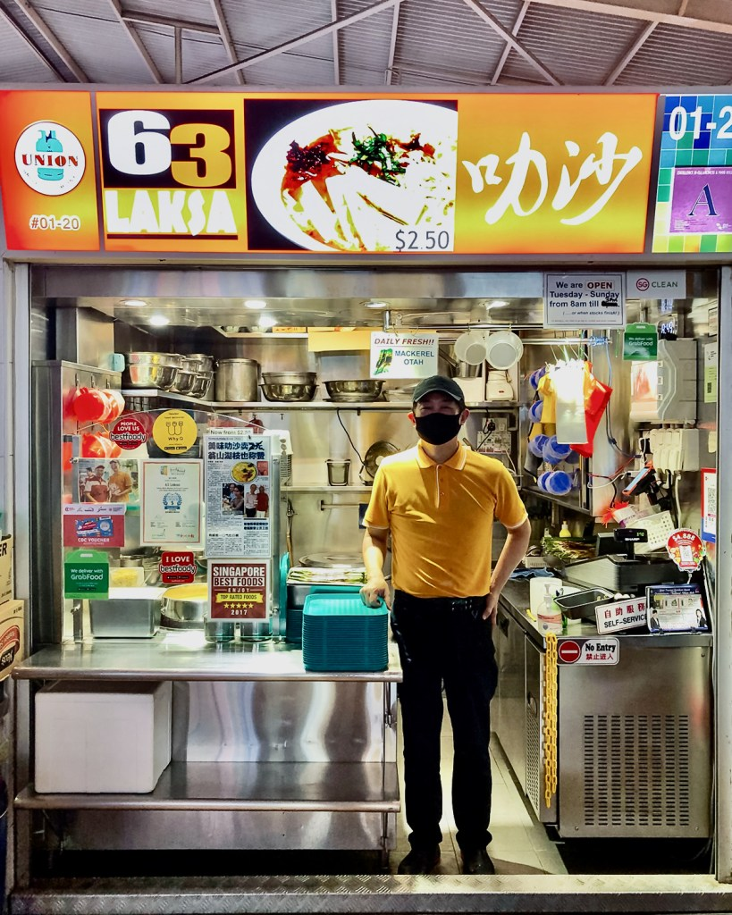 Kelley Ng standing in front of his Laksa Stall (Olivia Lee)