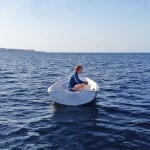 Erland Øye in a boat in Sicily (Metatron Music)