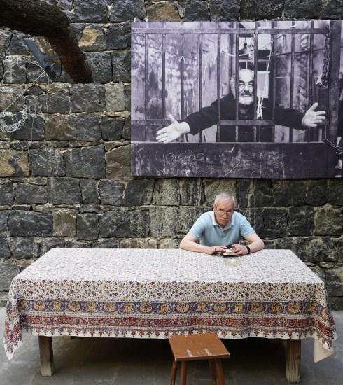 Man sitting outside Sergei Parajanov Museum (Peter Moore)