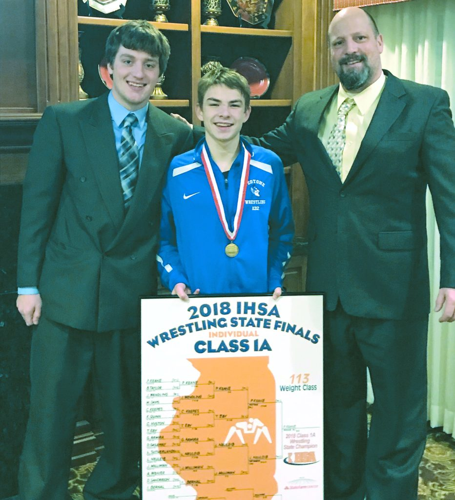Paul Keane was the top wrestler Saturday, capturing the State Title at 113 pounds in 1A. Pictured are (l. to r.): Coach Kody Goberville, Paul Keane, and Coach Greg Goberville.
