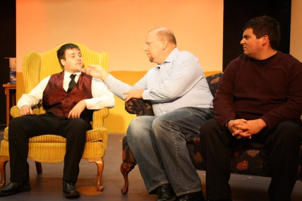 Bruce (Kevin Christian) is jealous that Bob (Joe Forstromm) is getting along so well with the waiter, Andrew (Bob Harris).