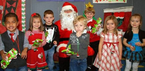 SURPRISE SANTA ... Shown with Santa are (LEFT TO RIGHT) Isaiah Gracia (Stryker); Cara Schroeder (Bryan); Maddox Oyer (Napoleon); Brody Meienburg (Defiance); Khristopher Alspaugh (Bryan); Ariah Bagrowski (Wauseon); and Hayden Palmerton (Montpelier). Openings in the Four County Career Center's Day Care are available for the coming new year. For information about registering, call 1-800-589-3334, Ext. 2360.