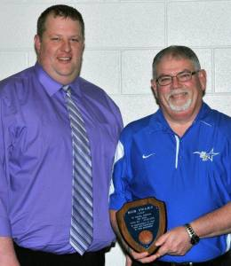 "COACH'S AWARD … Lady Bombers JV Coach John Gallehue (left) honored his friend and colleague, Varsity Coach Bob Swary (right), with a special award during Edon's Winter Athletic Awards Night.  ""He's taught me more about the game of basketball ~ and about life ~ and has given me advice on everything,"" shared Gallehue.  ""He's a great guy and this is a long time coming.""  Throughout his sixteen varsity seasons, Coach Swary amassed a record of one hundred ninety-six wins and during his four-year tenure with the Lady Bombers (2009-2013), became the second winningest coach in the program's history.  His time and dedication to girls basketball for twenty-five years as a coach ~ both at Edon and Edgerton ~ is greatly appreciated by players, parents and fans alike."