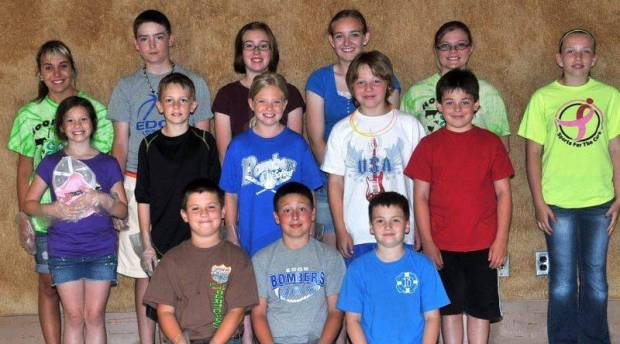 COMMUNITY SERVICE … Each year, Hoofbeats 4-H Club members give back to their community by hosting the Edon Senior Center's June Birthday and Anniversary celebration.  Taking a quick break from clean-up duties were, from left, front row: Tanner Stickney, Jobe Carlson, Gradyn Monachino; middle row: Shelby Cope, Dayton Cope, Carlie Kiess, Andrew Derico, Adam Derico and back row: Alyssa Chaffee, Evan Fisk, Grace Monachino, Becky Fisk, Crista Wortkoetter and Emily Kissinger.