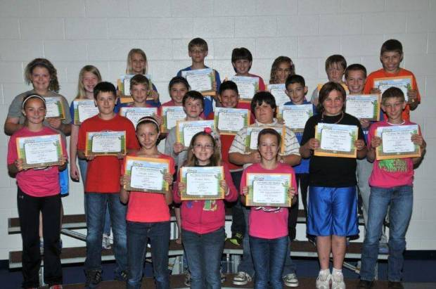 FIFTH GRADE BUG AWARDS … Fifth Graders honored for bringing up their grades during the 2012-2013 Fourth Nine Week Grading Period in Miss Free's and Mr. England's classes were:  Front row, from left, Hannah Ater, Michelle Bailey and Riley Bloir.  Second row, from left, Alea Brandt, Jacob Dulle, Clayton Fitch, Chase Goebel, Arianna Howard and Kase Hug.  Third row, from left, Zoe Maier, Brooklyn Morris, Aidan Muehlfeld, Cortney Pease, Blaze Resendez, Keagen Romine and Kelby Sapp.  Back row, from left, Ashlynne Shaw, Connor Skiles, Natasha Warner, Naudia Warner, Nick Weidner and Shane Zulch.  Not pictured ~ Jonathan Gray, Kayla Kurtz, Dylan Mason and Tyler Trevino.