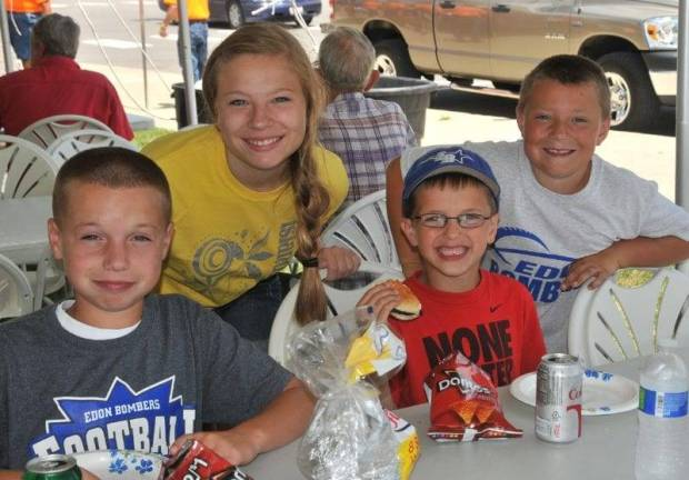 SUMMER FUN … Kelby Sapp, Samantha Trausch, Kyler Sapp and Jarrett Trausch, from left, joined other Edon area residents for a few hours of fun, food and fellowship at The Edon State Bank Company's 16th Annual Customer Appreciation Day.