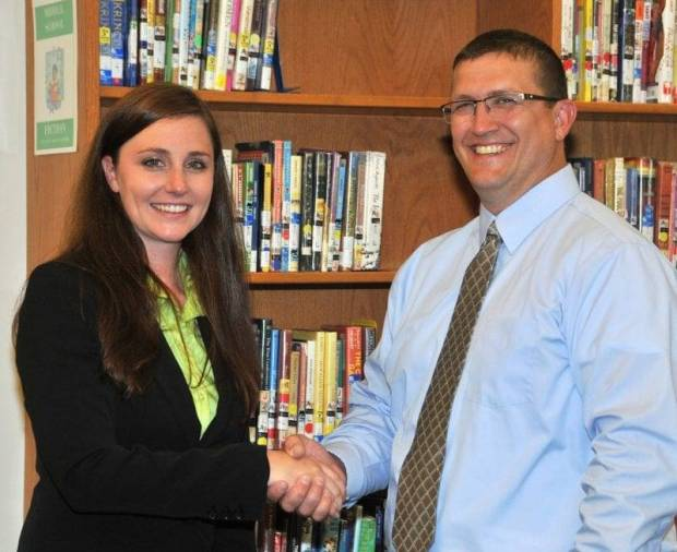 NEW TEACHER … Edon Superintendent Ed Ewers congratulates Amanda Reiter on her new position at Edon Northwest Local Schools.  Ms. Reiter's one-year contract as Guidance Counselor for 2013-2014 was approved by the District's Board of Education during its July's regular session.  The Pemberville native received both her undergraduate and graduate degrees from Bowling Green State University; she will be relocating to Hamilton Lake in the near future.