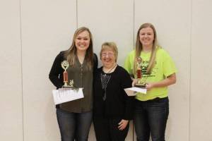 SUMNER AWARDS WINNERS ... From left: Emily Maneval, HS; Linda Sumner; Johnnie Roth, JH.