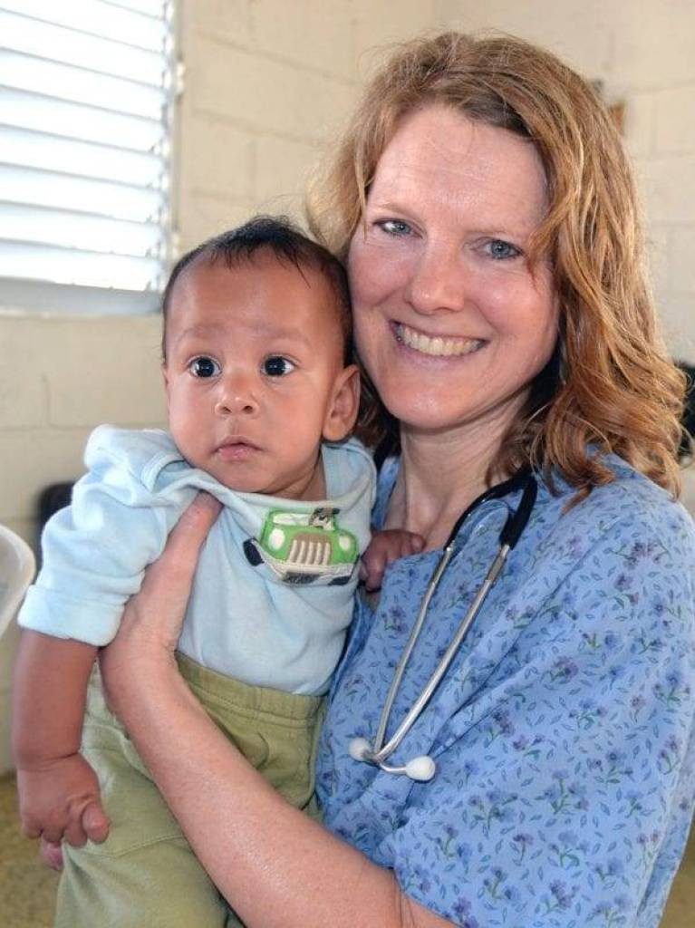 Photo #1 Penny holding a baby on her mission trip to the  Dominican Republic WEB