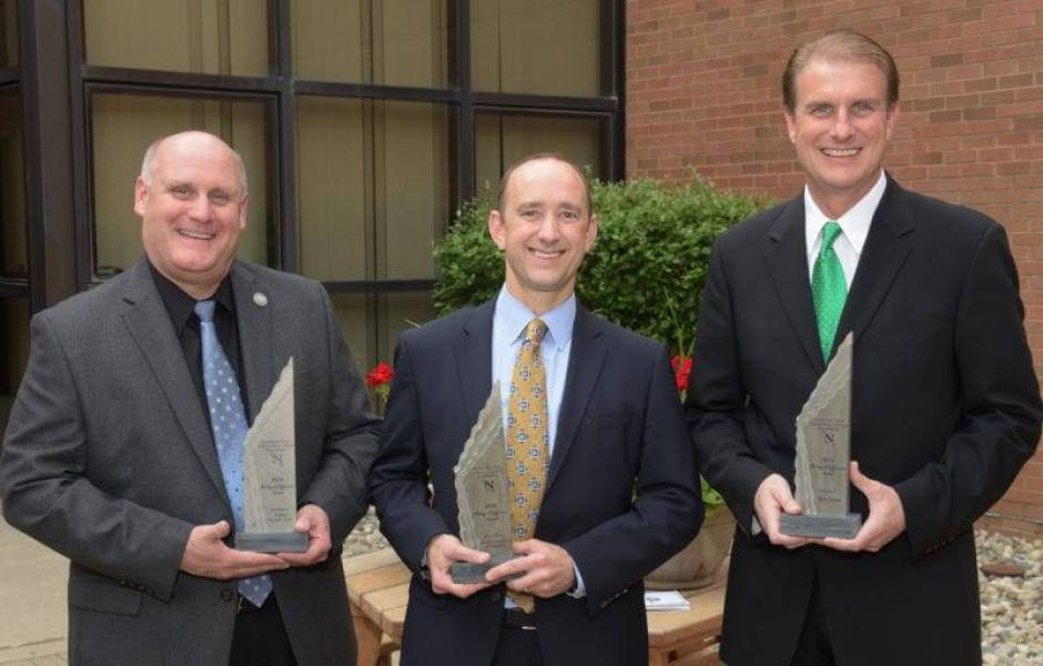 Todd Hanes, President and CEO of Adriel, Dr. Michael Carpenter, Dental Excellence of Napoleon and Rick Small, WDFM/Mix 98.1, holding their 2016 Making a Difference Awards.
