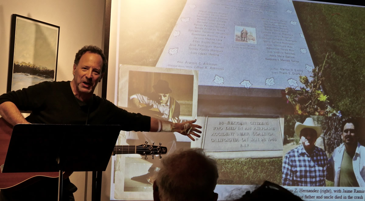 Will Kaufman with image showing a memorial to the Deportees (photo by Jeff Hodges)