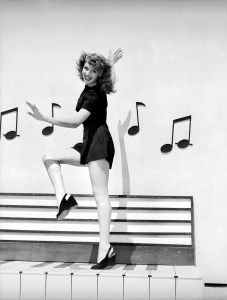 1944: Rita Hayworth (1918 - 1987) dances along an outsize piano keyboard, surrounded by musical notes, in the film 'Cover Girl', directed by Charles Vidor. (Photo by Ned Scott)