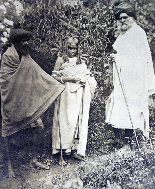 Photograph of two Toda men and a woman. Nilgiri Hills, 1871.