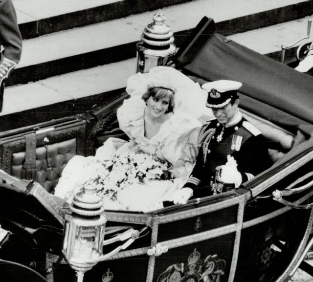 Princess Diana and Prince Charles at their wedding.  Princess Diana's wedding dress somehow fitted into this carriage.