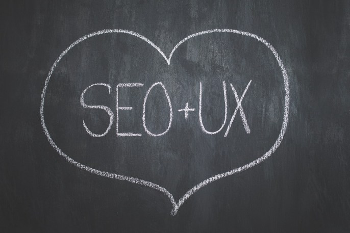 SEO + UX written on a chalkboard, showing one of the advantages of web accessibility.