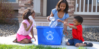 Parent teaching her children the importance of being eco-friendly. (Photo by: viafilms | iStock via Getty Images Plus)