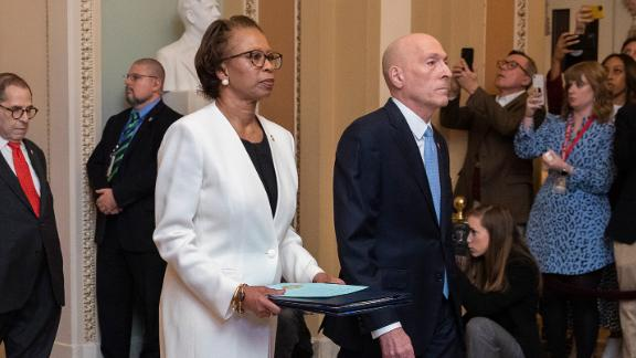 House Sergeant at Arms Paul Irving and Clerk of the House Cheryl Johnson carry the articles of impeachment against President Donald Trump to Secretary of the Senate Julie Adams on Capitol Hill in Washington, Wednesday, Jan. 15, 2020. Following are impeachment managers, House Judiciary Committee Chairman, Rep. Jerrold Nadler, D-N.Y., House Intelligence Committee Chairman Adam Schiff, D-Calif., Rep. Hakeem Jeffries, D-N.Y., Rep. Sylvia Garcia, D-Texas, Rep. Val Demings, D-Fla., Rep. Zoe Lofgren, D-Calif., and Rep. Jason Crow, D-Colo. (AP Photo/Manuel Balce Ceneta) , Wednesday, Jan. 15, 2020. (AP Photo/Manuel Balce Ceneta)
