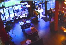 Security video shows man smashing restaurant windows with rocks... with people inside. (Source: KCPQ, Tribune, Colin Pickering)