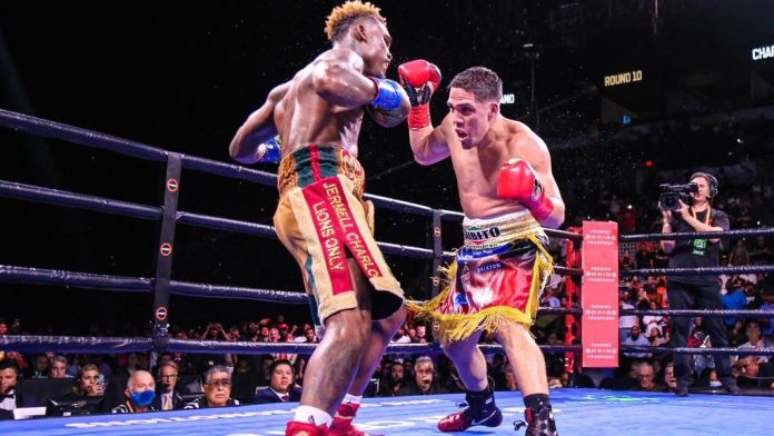 Brian Castaño (right) pressured Jermell Charlo throughout Saturday's 154-pound unification fight and got the better of the action along the ropes. But the split decision after 12 rounds left fans and analysts clamoring for a rematch. (Leo Wilson Jr./PBC)