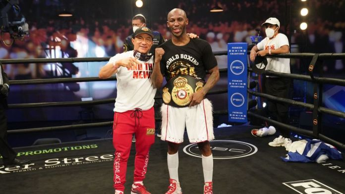 """Legendary Cuban trainer Ismael Salas (left) is confident of victory for WBA welterweight champion Yordenis Ugas (right). """"For Manny Pacquiao, we worked with very high caliber southpaws. If you check Yordenis' record, he's always beating them, said Salas.Photo credit: Sean Michael Ham/TGB Promotions."""