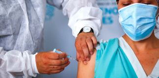 Maria Arreola, a nurse at Isidoro Iriarte Hospital, receives the first dose of 'Gam-COVID-Vac' also known as Sputnik V vaccine against coronavirus in Quilmes, Argentina. (Marcos Brindicci/Getty Images)