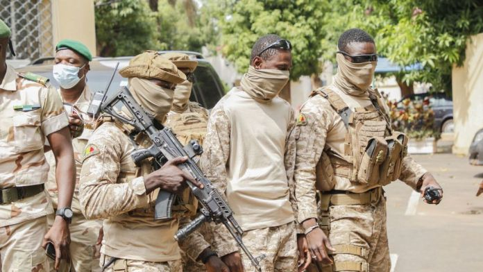 The leaders of the committee that overthrew former Malian President Ibrahim Boubacar Keïta arrive for negotiations with West African leaders in Bamako, Mali, in Aug. 2020. (John Kalapo/Getty Images)