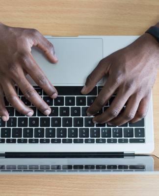 black man using laptop (Photo by: Cytonn Photography | pexels.com)