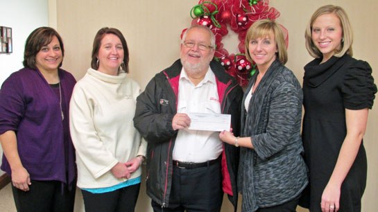 Leland Smith gives to Salvation Army 12-2013