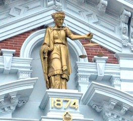 The 8-foot-tall statue of Lady Justice was refurbished and gilded as part of the recent Van Wert County Courthouse exterior renovation project. (Dave Mosier/Van Wert independent)