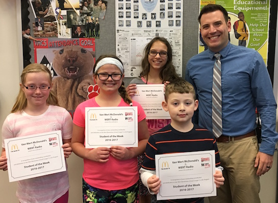 Congratulations to the Van Wert Elementary School students chosen for the Word of the Week award!  Pictured with Mr. Krogman, Assistant Principal, are students recognized for paying attention and being good listeners.  Award winners this week are Ethan, grade 1; Ella, grade 2; Angel, grade 3 (not pictured); Mia, grade 4; and Cassie, grade 5.  Each child received a free Mighty Kids Meal from our local McDonalds, a free taco from our local Taco Bell, and a certificate from WERT Radio. (Photo submitted.)