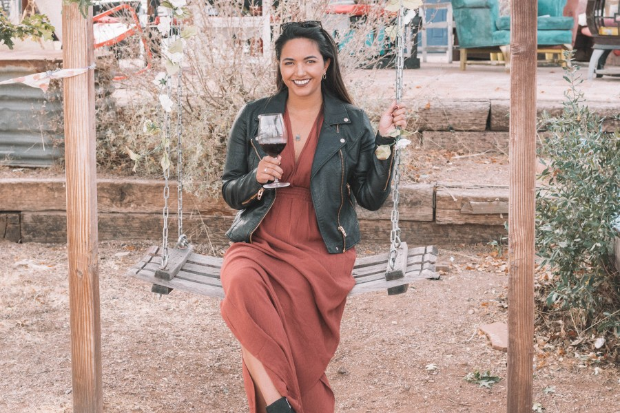 The perfect wine tasting outfit features a long dress and a moto jacket for some added edge!