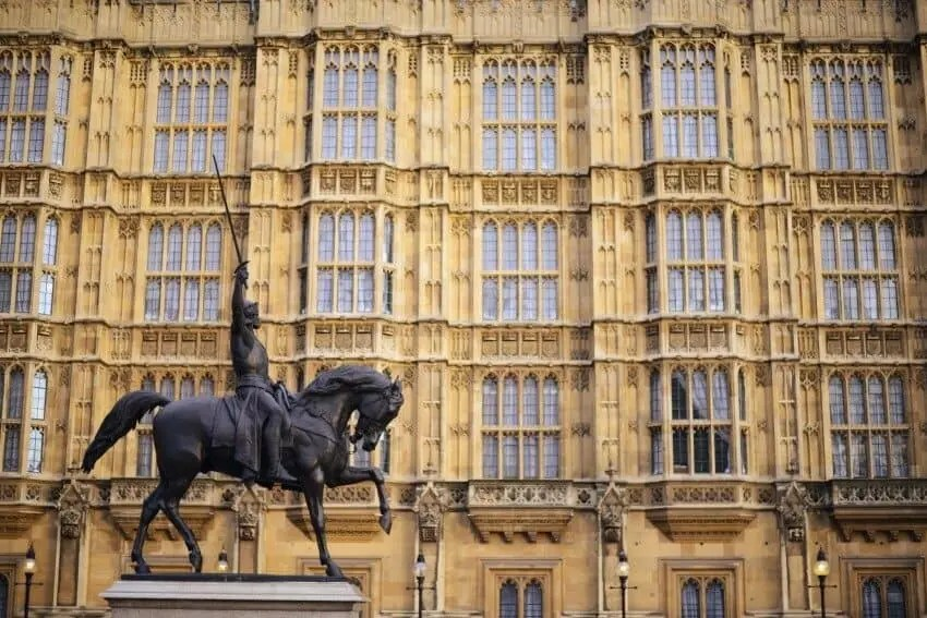 Photographed alongside the Houses of Parliament.