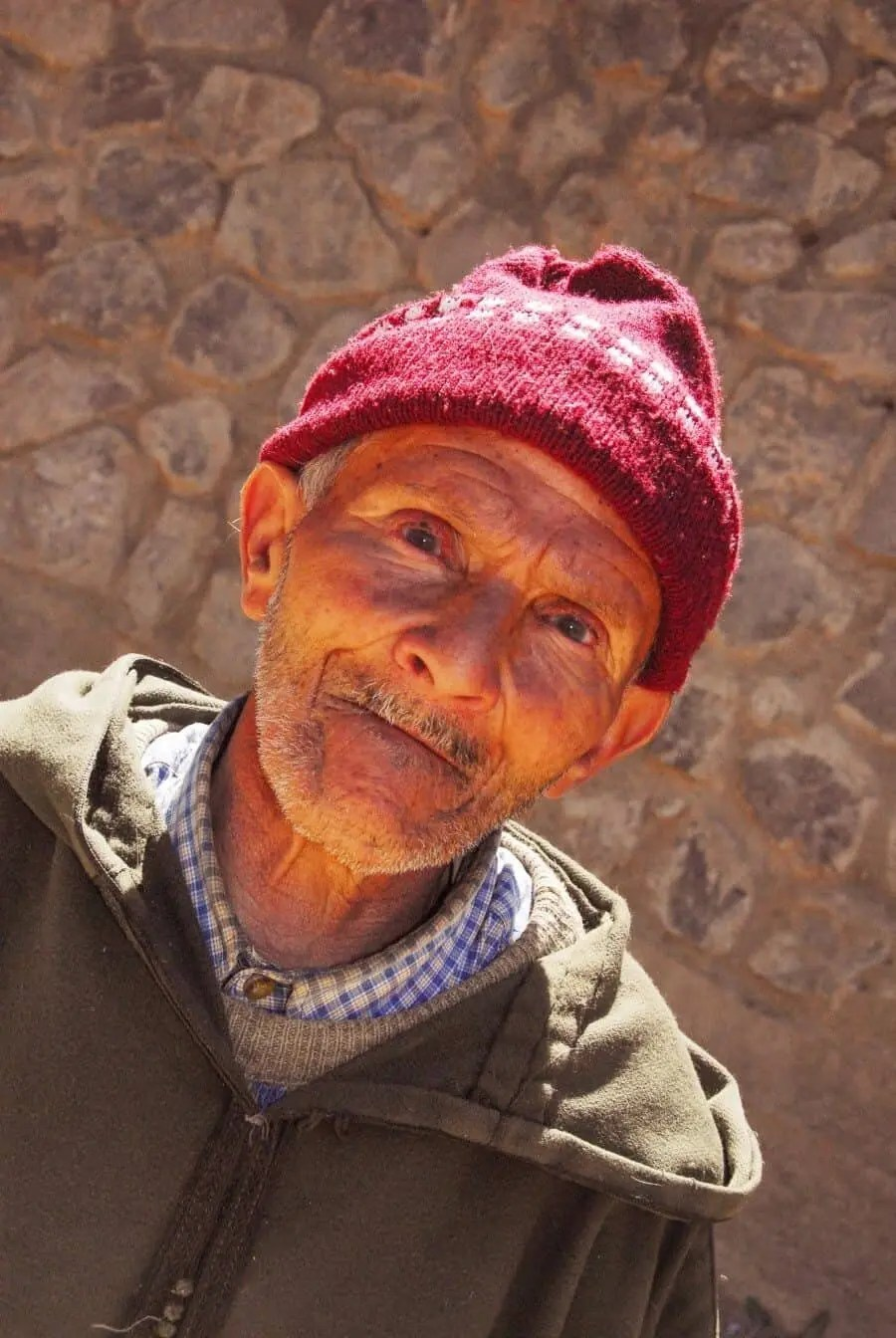 Imlil, Morocco: We were hiking in the Atlas Mountains when I stayed back to take some photos of the landscape. I soon noticed a lonely figure approaching from a path higher up and as he slowly walked towards me he stopped to stare and I showed him the photo I had taken. He put his hand out then stood and I assumed he wanted his portrait taken...I gave him an Australian dollar which he studied and then showed him his portrait which put a little smile on his face. Then he continued his walk down the mountain and I took a deep breath thankful for such an interaction.