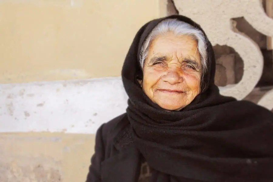 Crete, Greece: After seeing her beautiful face watching people walk by, I couldn't resist approaching this woman to take her portrait. Smiling happily, you can almost feel the stories in her eyes.