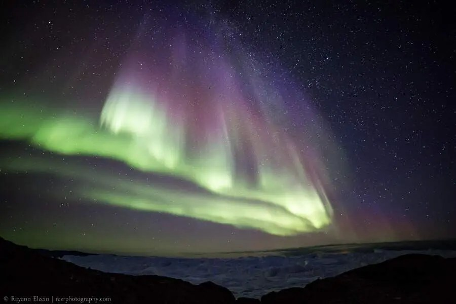 Northern lights and icebergs at the Unesco Ilulissat Icefjord in Greenland