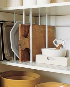 Organize RV cupboards with curtain tension rods placed vertically
