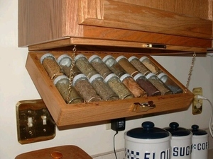 RV space solutions: Fold-out spice rack installed under a cupboard