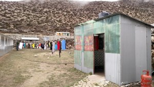 Shower in Dingboche. Uninsulated tin structure out in the cold with gravity (no pressure) fed water from a tank on the roof.