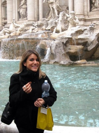 Tossing a coin into the Trevi Fountain, Rome, Italy