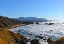 Cannon Beach in the Ekola Nature Park is famous for its vibrant sunsets and views of cliffs towering in the middle of the water