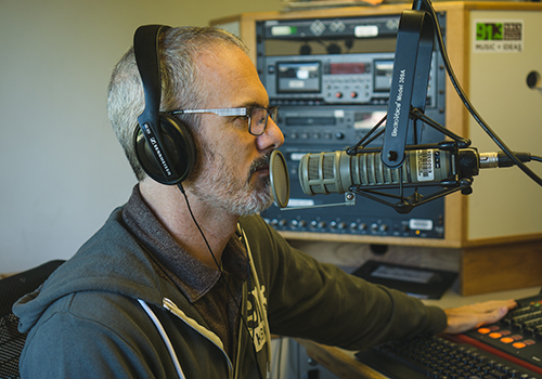 Patrick Whalen behind the mic at the KBCS studio.
