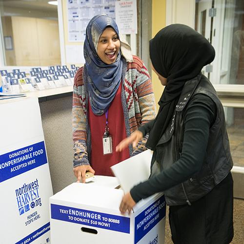 Rotaract Club members prepare food drive boxes.