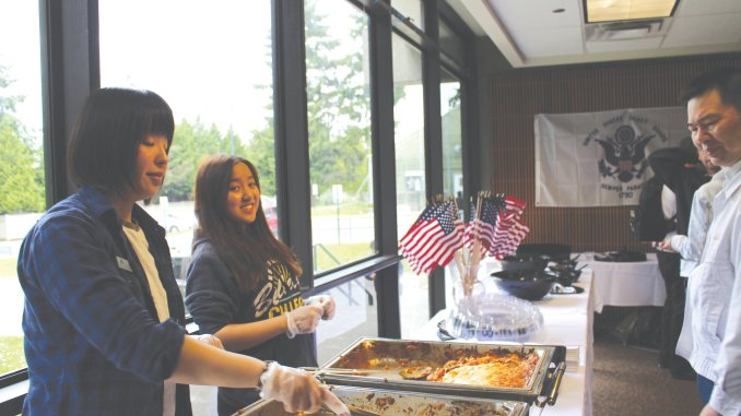 Volunteers serving lunch at the Memorial Day Event.