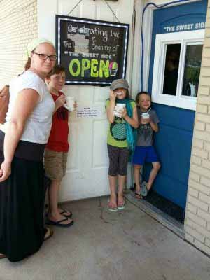 A family enjoying a snowdome at The Sweet Side in North Richland Hills