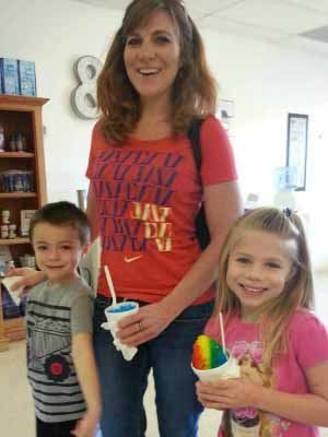 First timers at The Sweet Side in North Richland Hills enjoying snowdomes made with purific snow