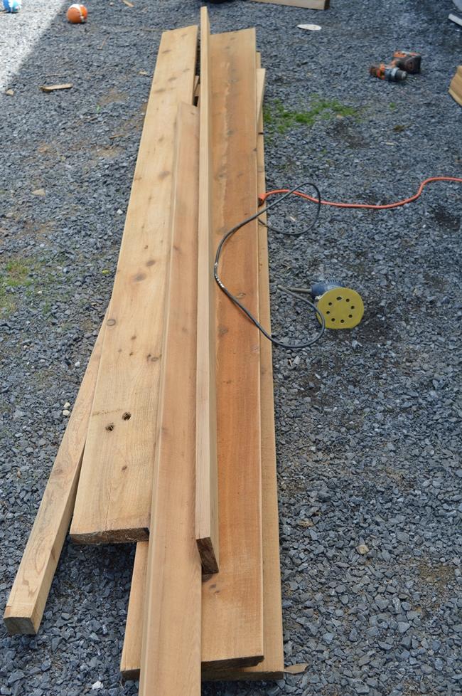 rough cut cedar lumber for a planter box