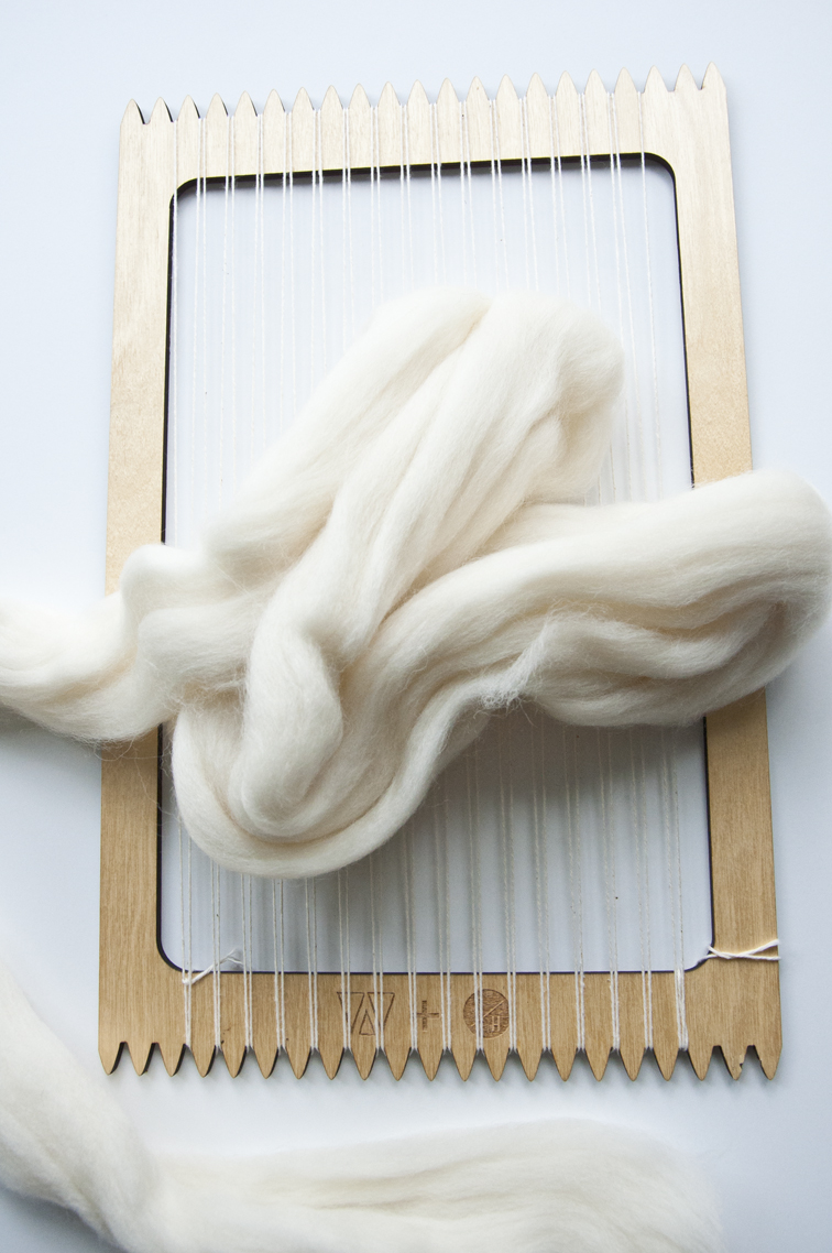 Steps on twisting and weaving wool roving to look like fluffy rope!